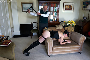 Sir John shows Molly that corporal punishment is no laughing matter