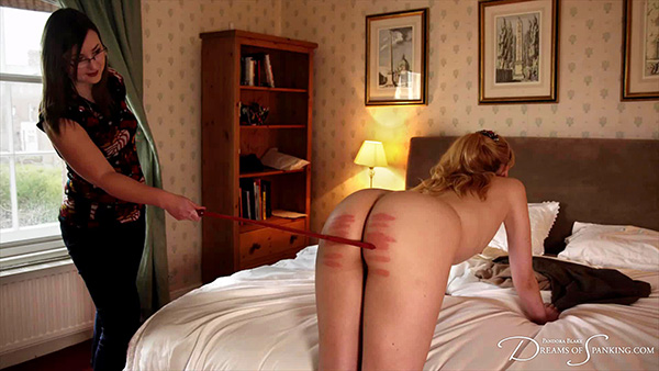 Ariel Anderssen (Amelia Jane Rutherford) takes a severe cold caning on the bare bottom - free spanking video from Dreams of Spanking