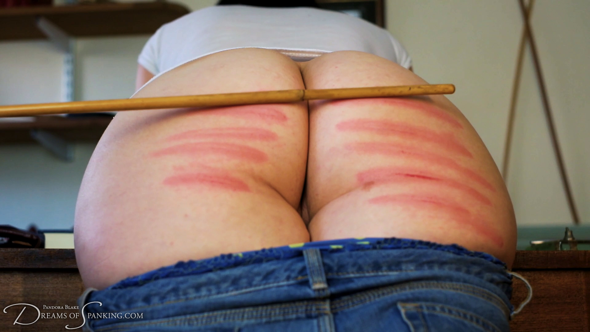 Pandora Blake caned at Dreams of Spanking
