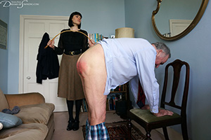 Distinguished Sir John caned by the strict Headmistress