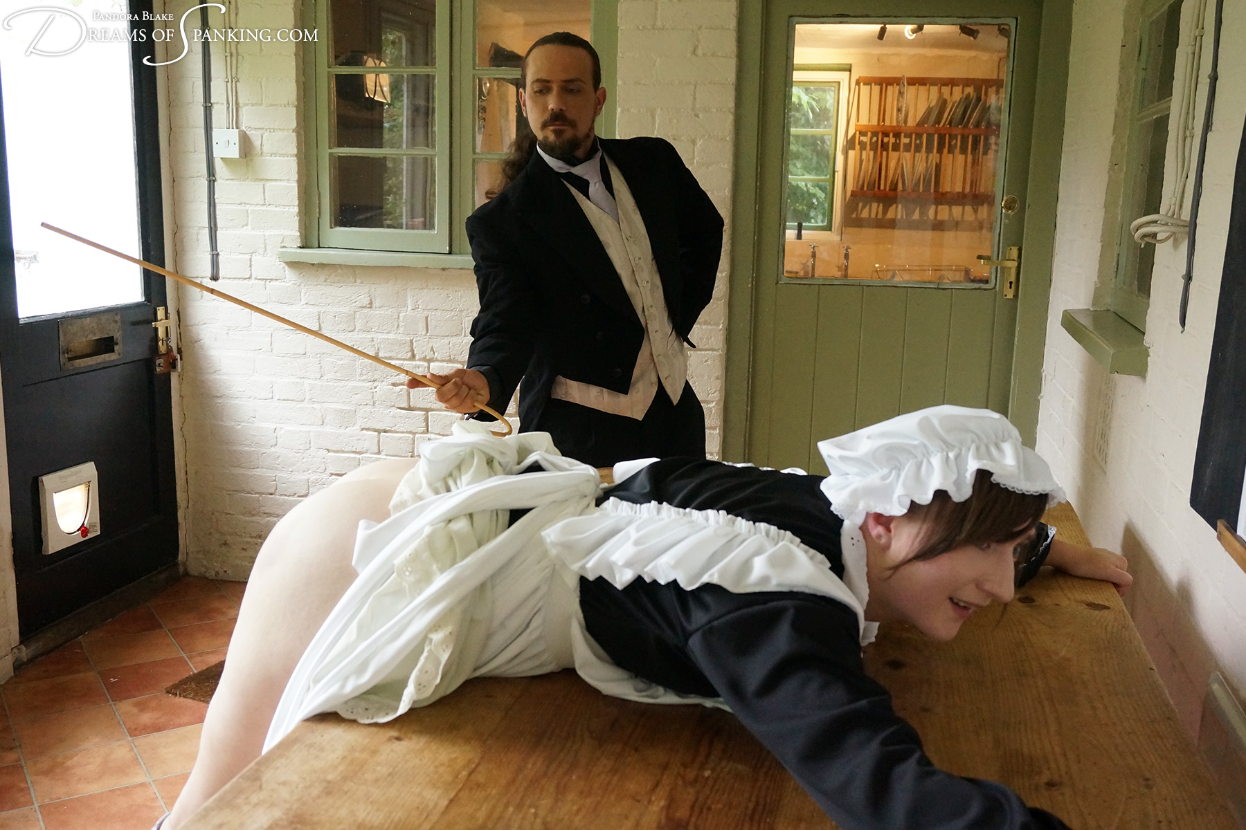 Whipped Victorian maid Pandora Blake takes a 50-stroke severe caning at Dreams of Spanking