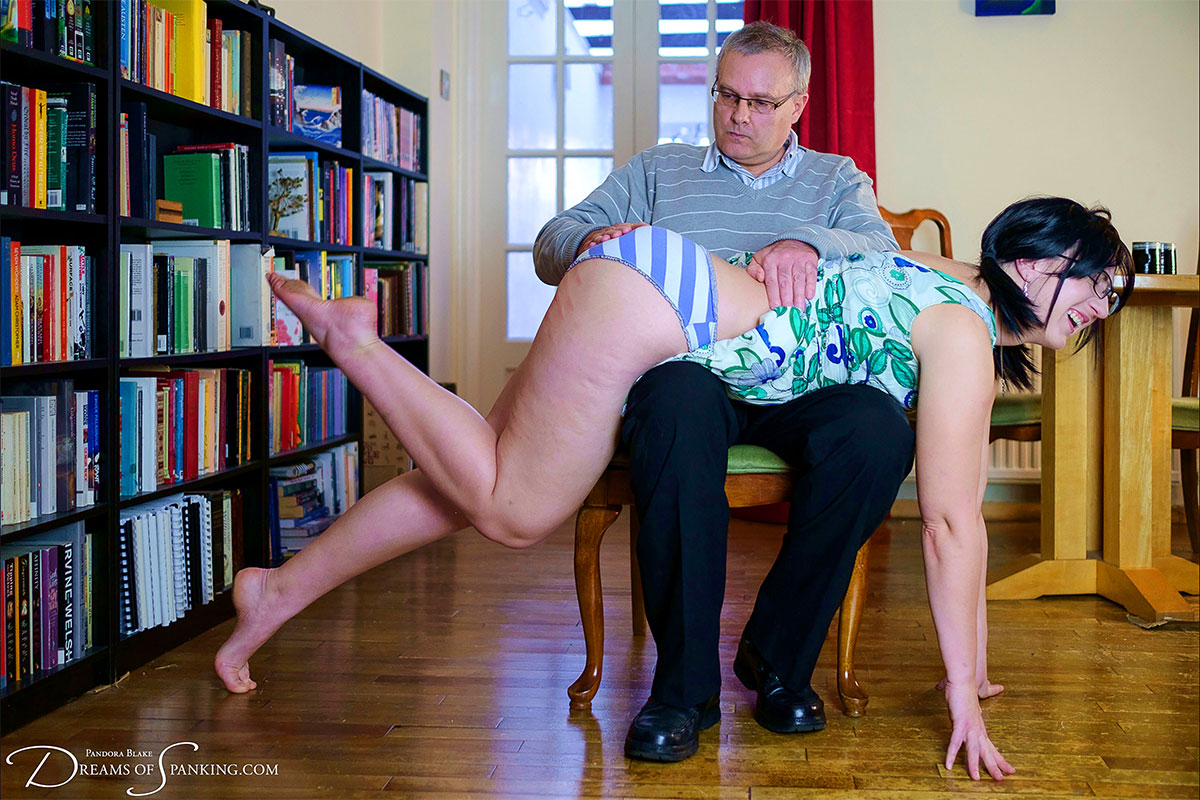Pandora Blake is spanked OTK at Dreams of Spanking