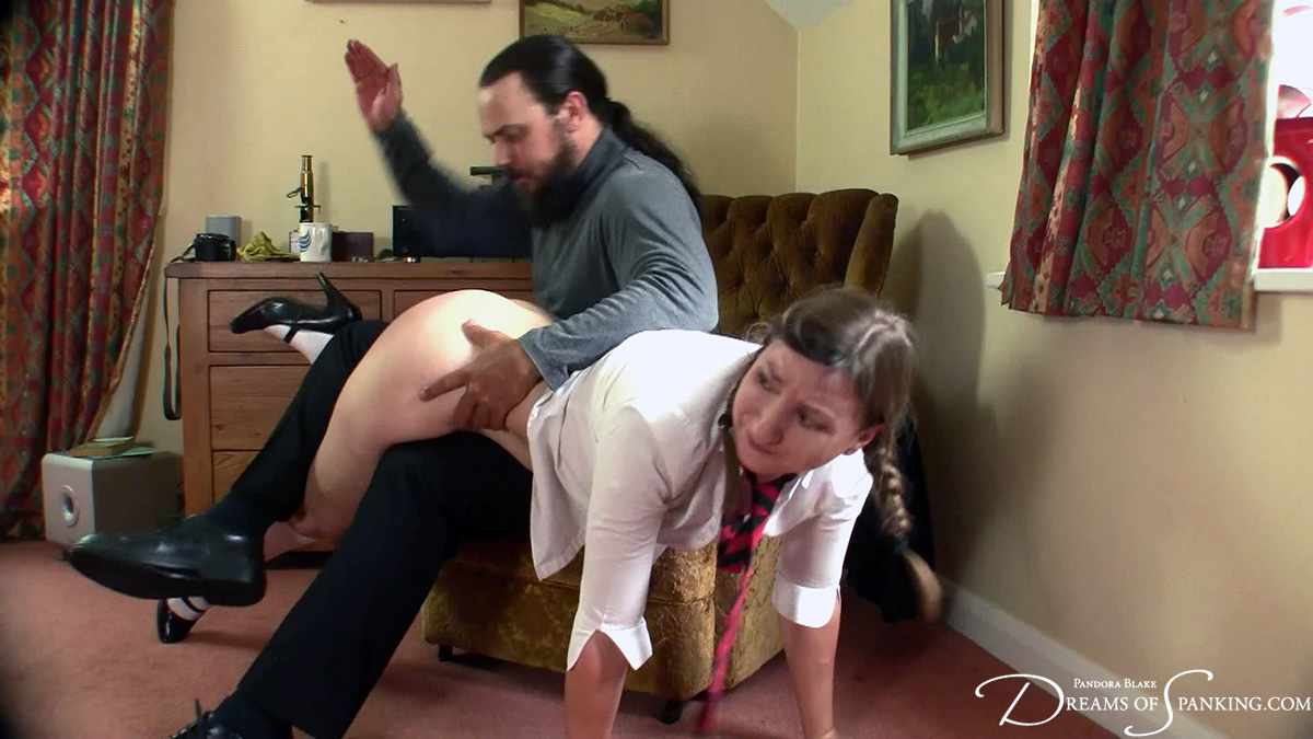 Pandora Blake takes a hard OTK school punishment at Dreams of Spanking
