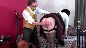 Victorian wench Pandora Blake whipped with a riding crop at Dreams of Spanking