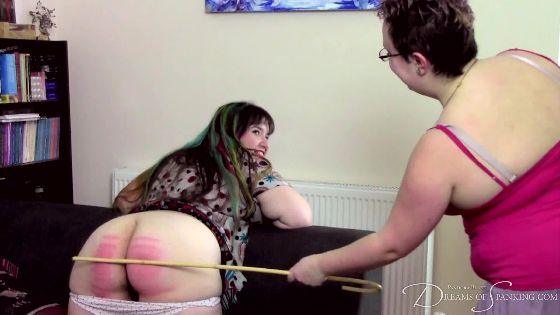 Free spanking video: Adele Haze takes a hard caning from Nimue Allen - Dreams of Spanking