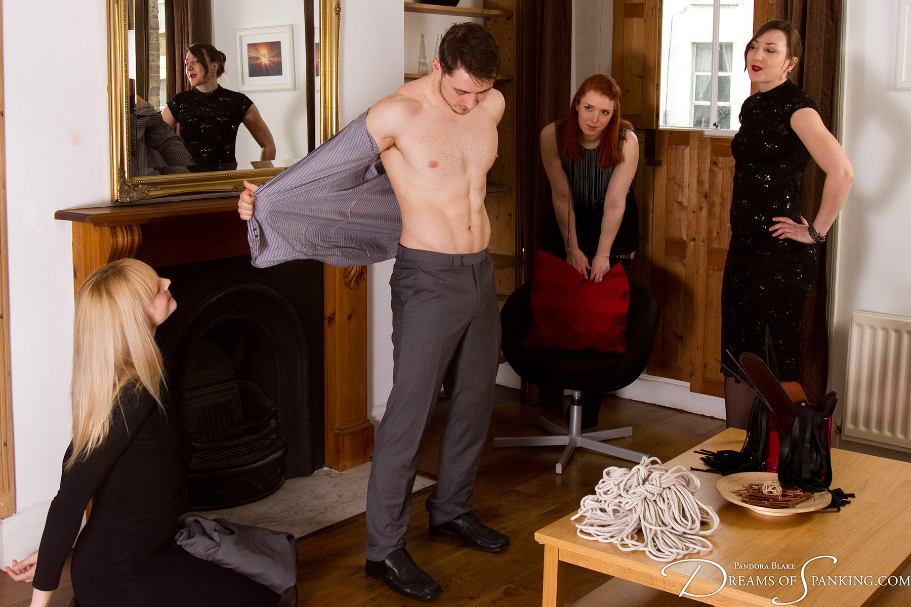 The Baroness' new houseboy presents himself for inspection and initiation.