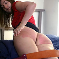 Pandora's Birthday Strapping at Dreams of Spanking