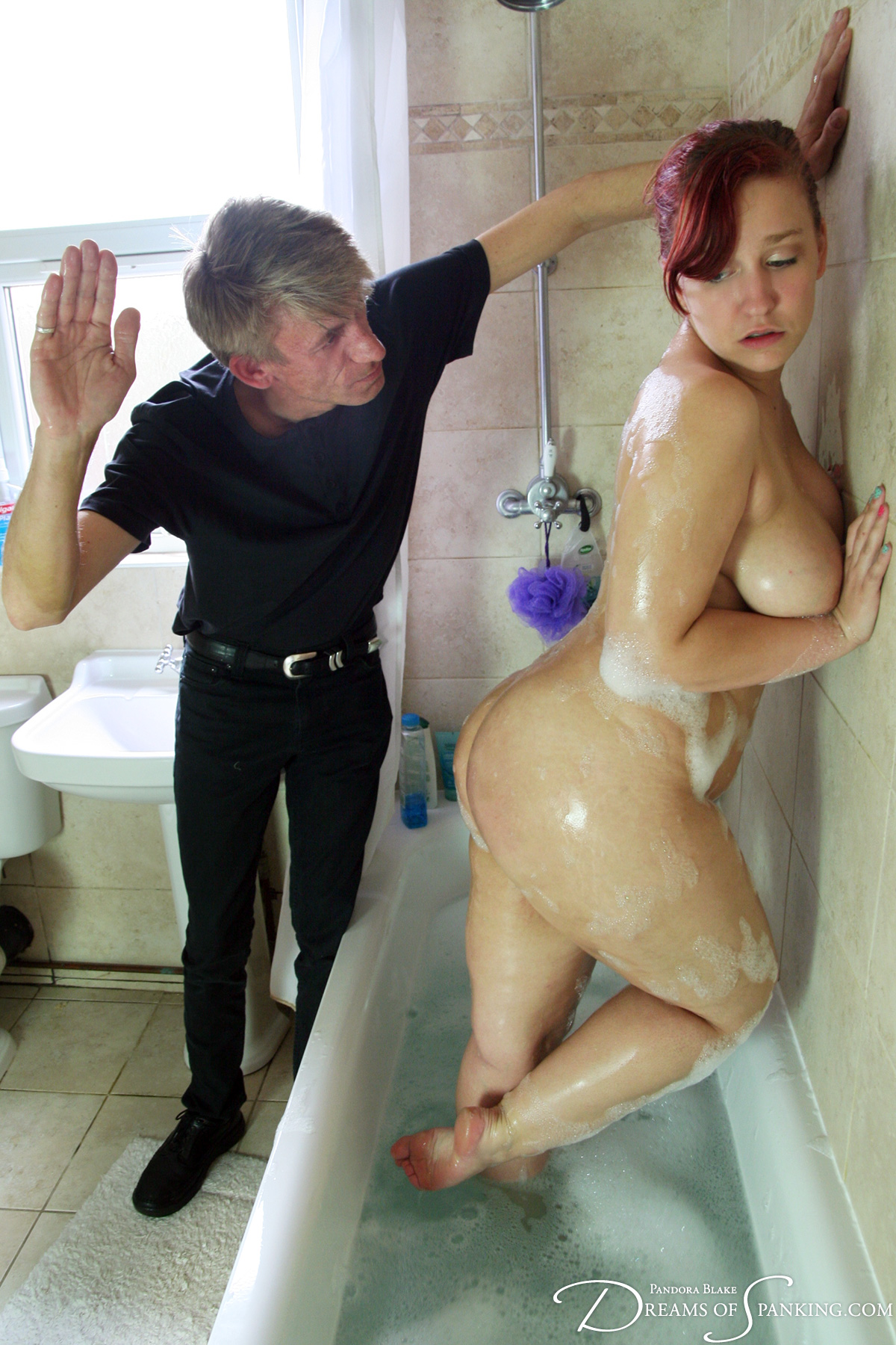 Mila Kohl spanked in the bath at Dreams of Spanking