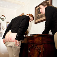 Zille Defeu and Pandora Blake caned in jodhpurs by Thomas Cameron - only at www.DreamsofSpanking.com