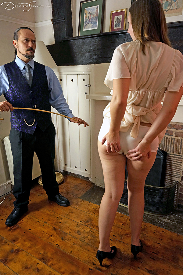 Pandora Blake lifts her dress for an embarrassing caning in the parlour