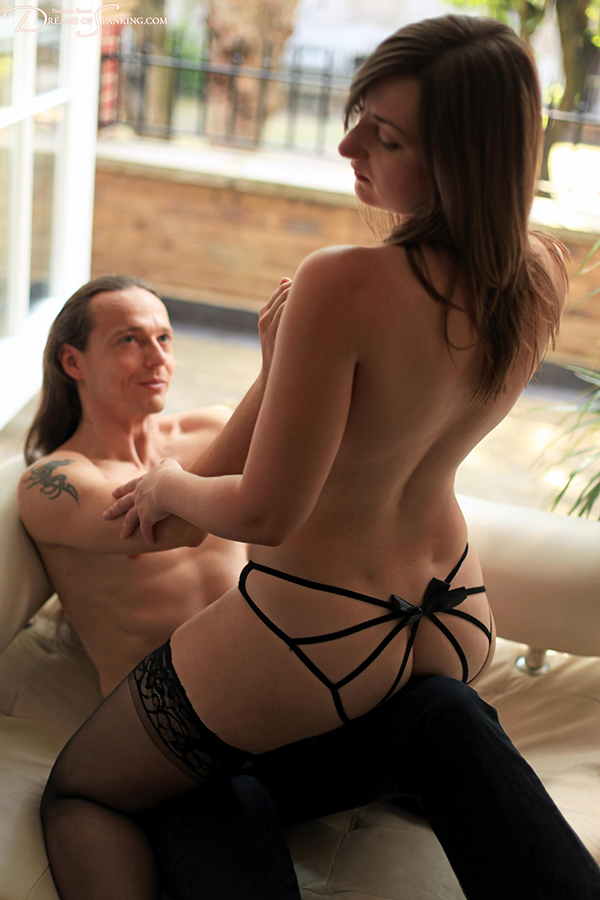 Sensual couple spanking in ribbon knickers and fetish heels at Dreams of Spanking