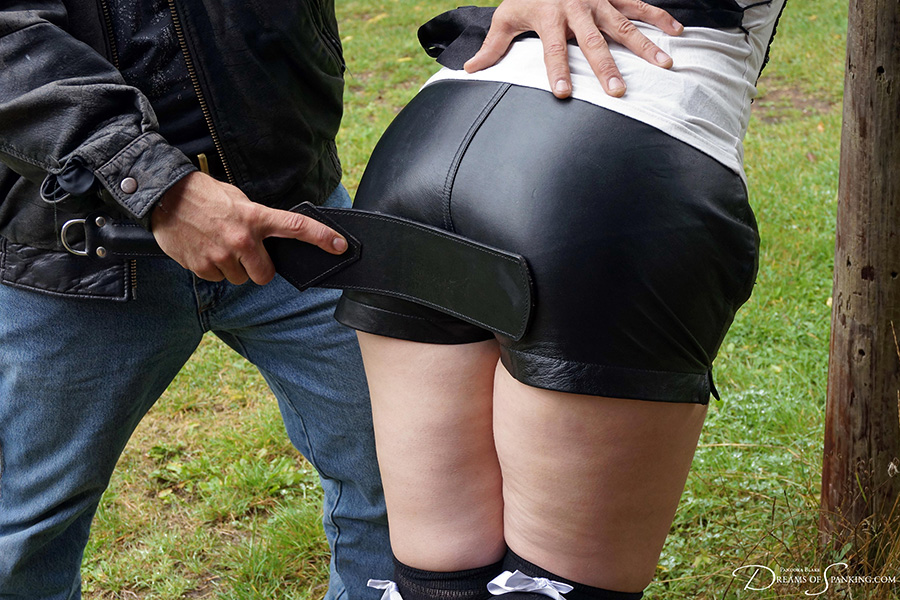 Pandora Blake spanked in leather shorts at Dreams of Spanking