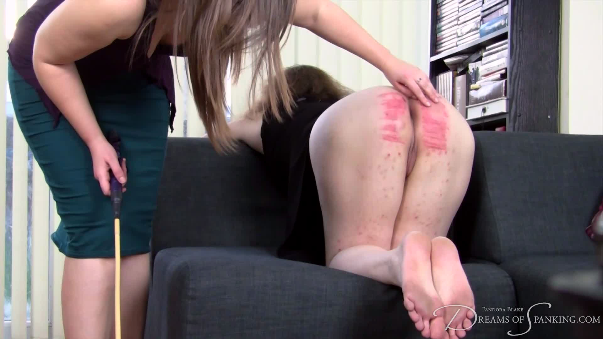 Porn activist Michelle Knight bends over to receive her first ever hard caning at Dreams of Spanking