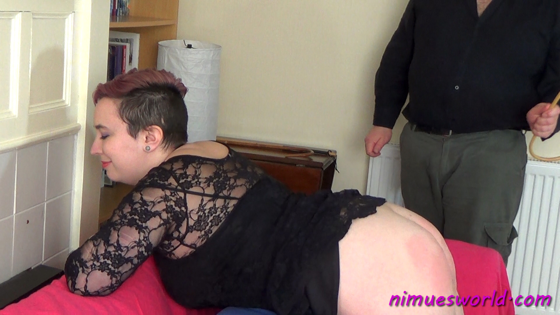 Nimue Allen bends over for 50 hard cane strokes in this free caning video