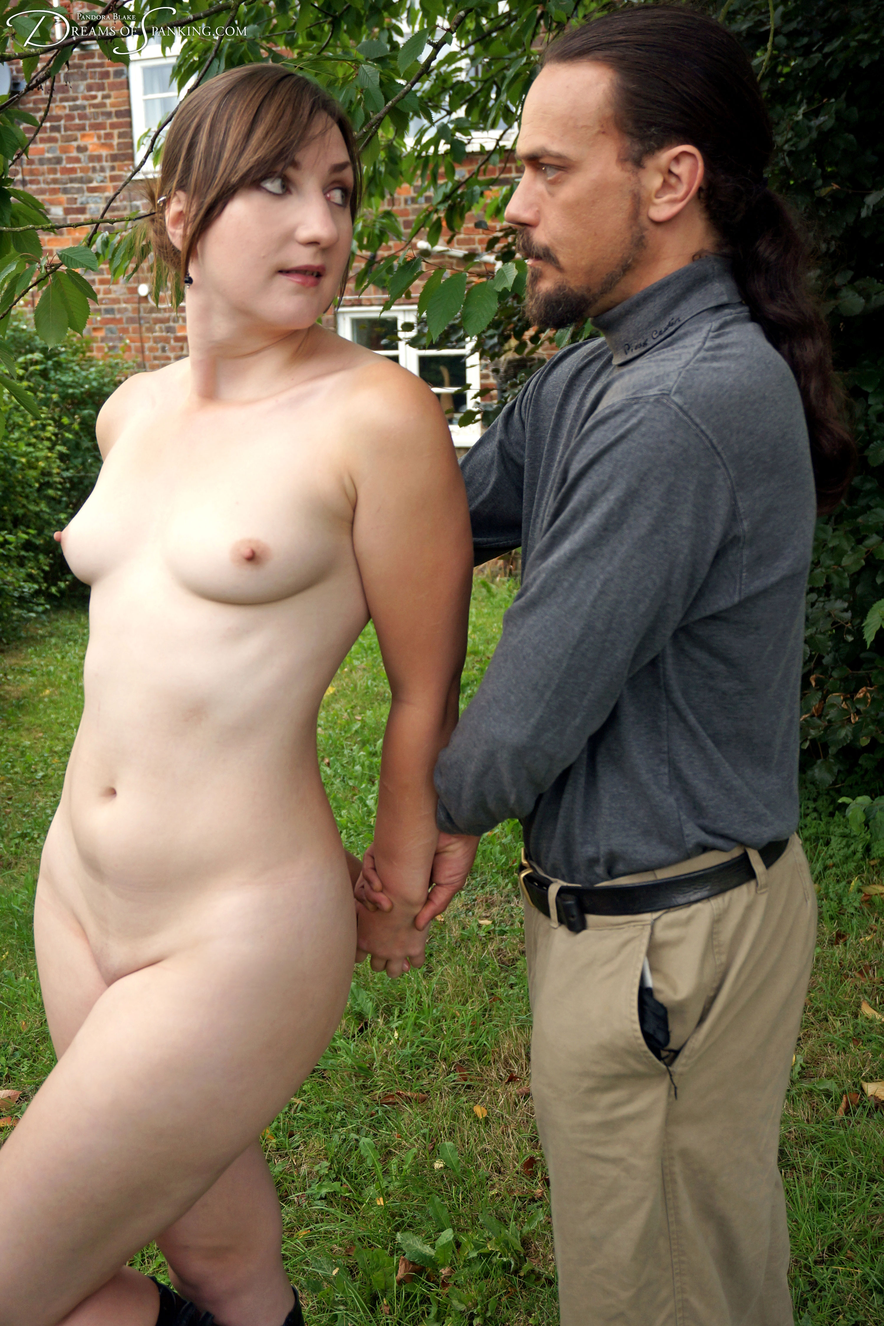 Pandora Blake is tied naked and birched in the garden at Dreams of Spanking