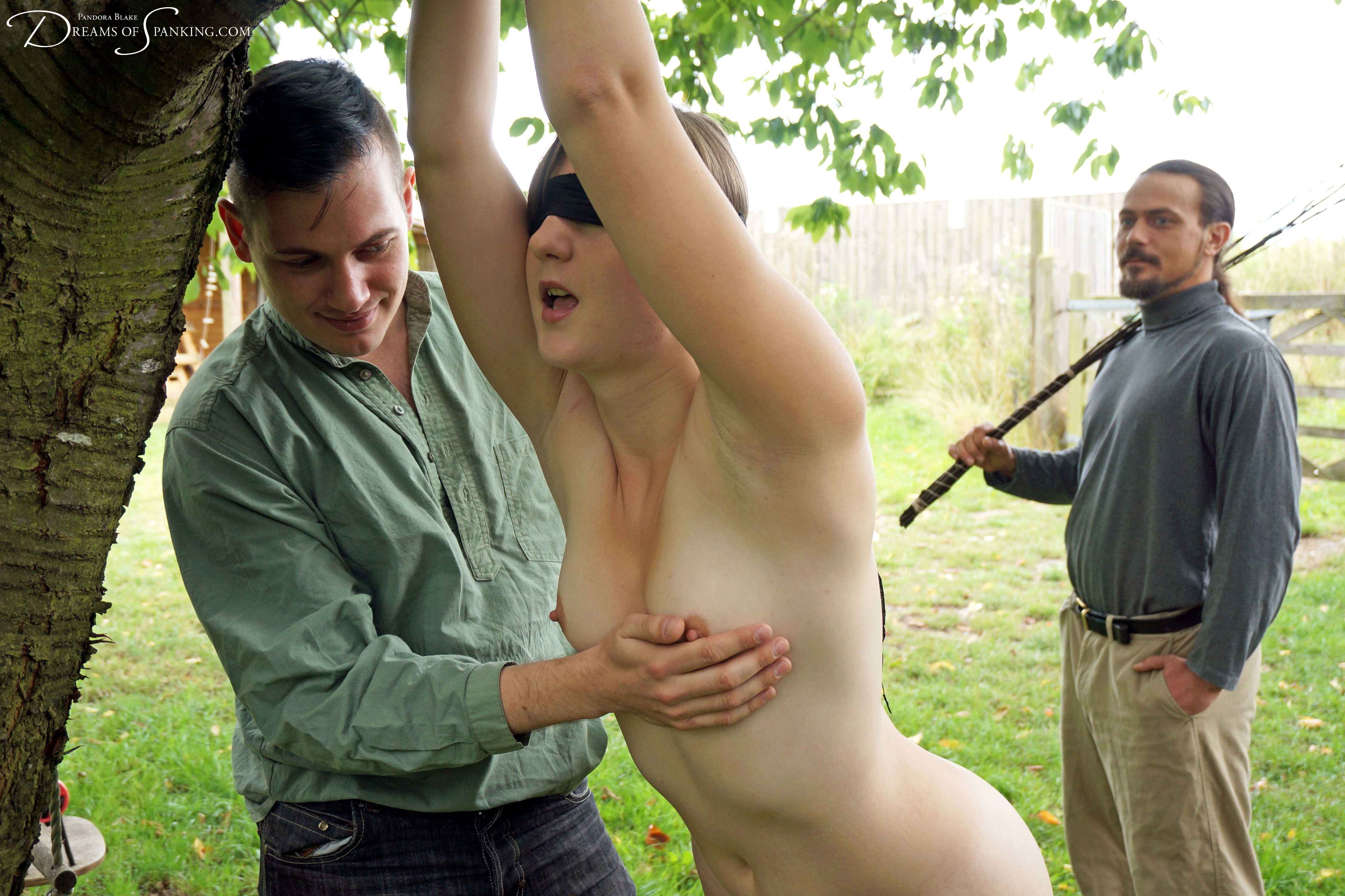 Pandora Blake is tied naked and punished in the garden at Dreams of Spanking