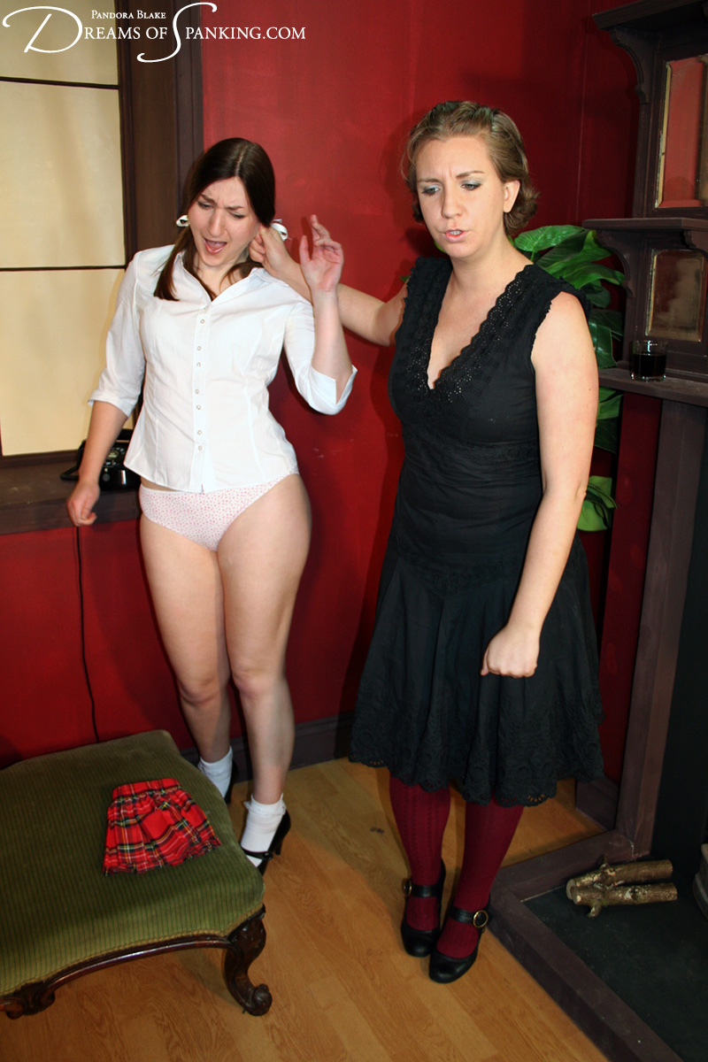 Little Tammy is spanked with aunty's  hairbrush at Dreams of Spanking