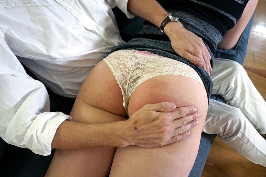 An over the knee hand spanking for Ten Amorette at Dreams of Spanking