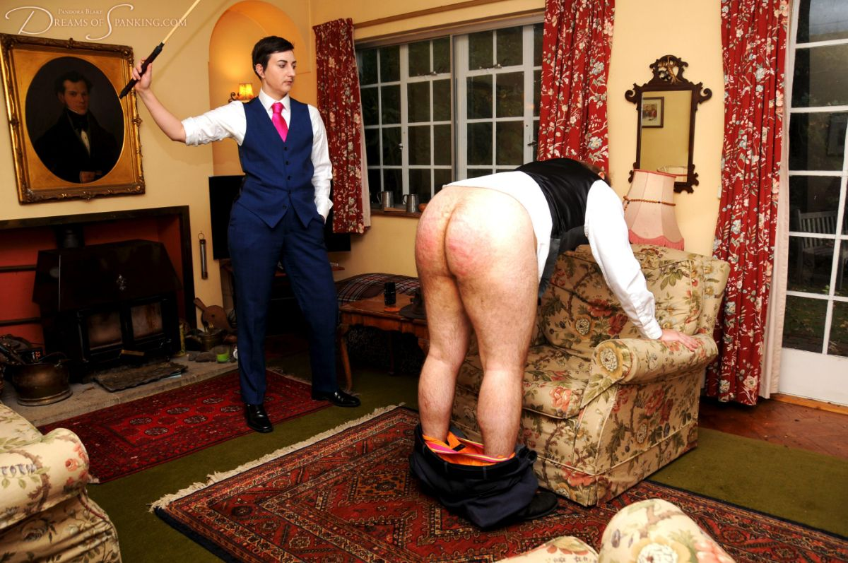 Blake canes Charlie J Forrest on the bare bottom at Dreams of Spanking