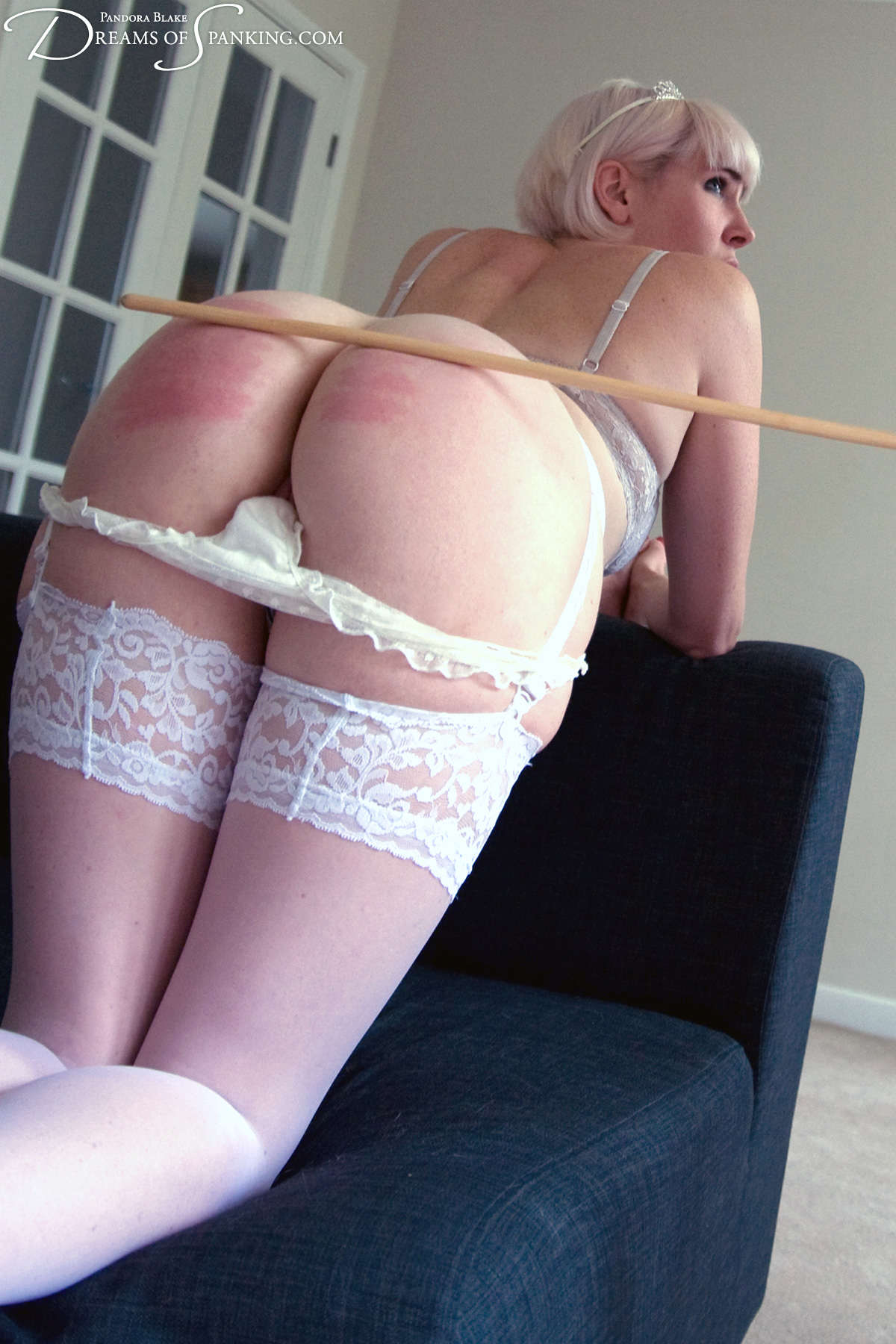 Out-of-control bride Molly Malone gets the cane at Dreams of Spanking