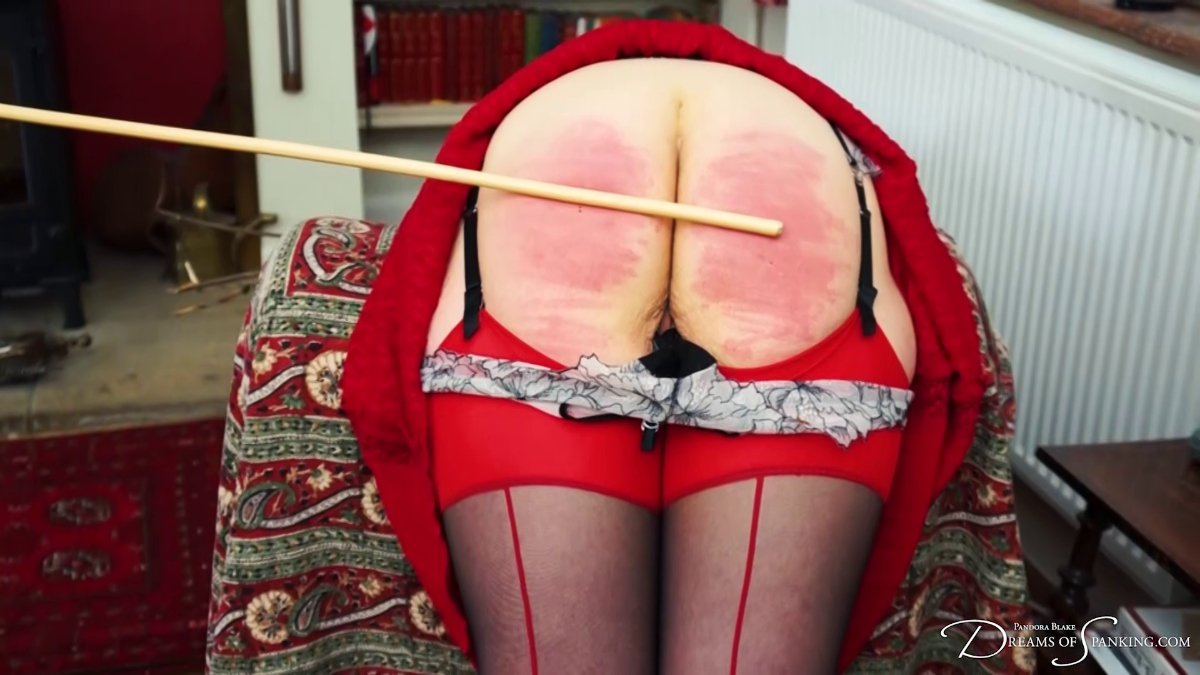 Emma Christie gets the cane on her bare bottom at Dreams of Spanking