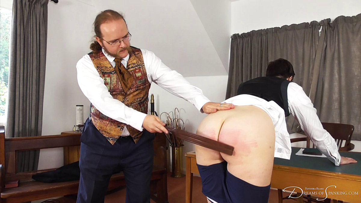 Pandora Blake gets the tawse from Charlie J Forrest at Dreams of Spanking