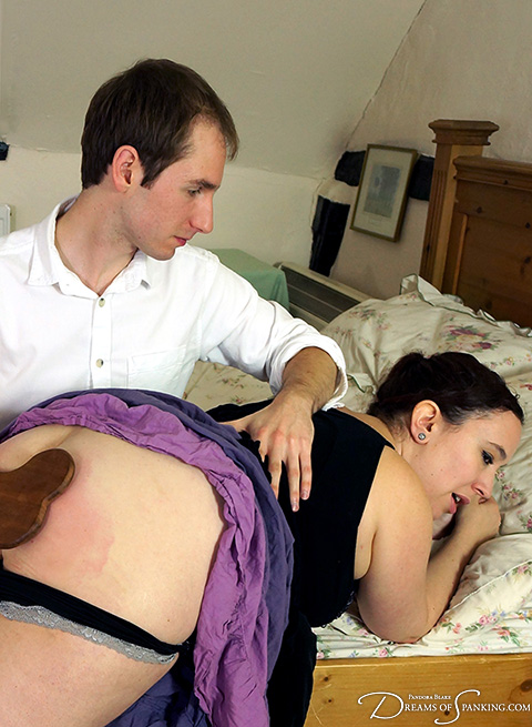 Over the knee bare bottom spanking - photo by Pandora Blake