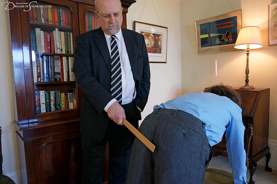 Strict wooden ruler punishment for a naughty university student