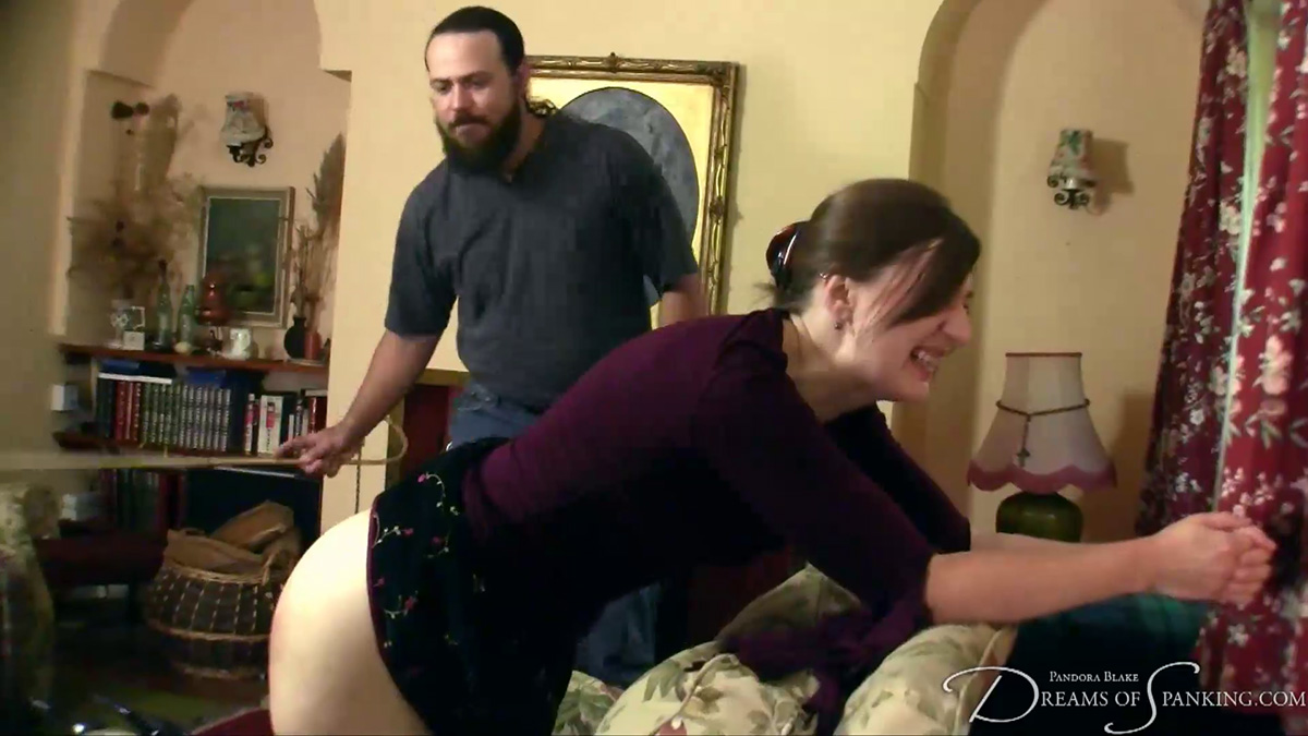 Pandora Blake asks for a double caning at Dreams of Spanking