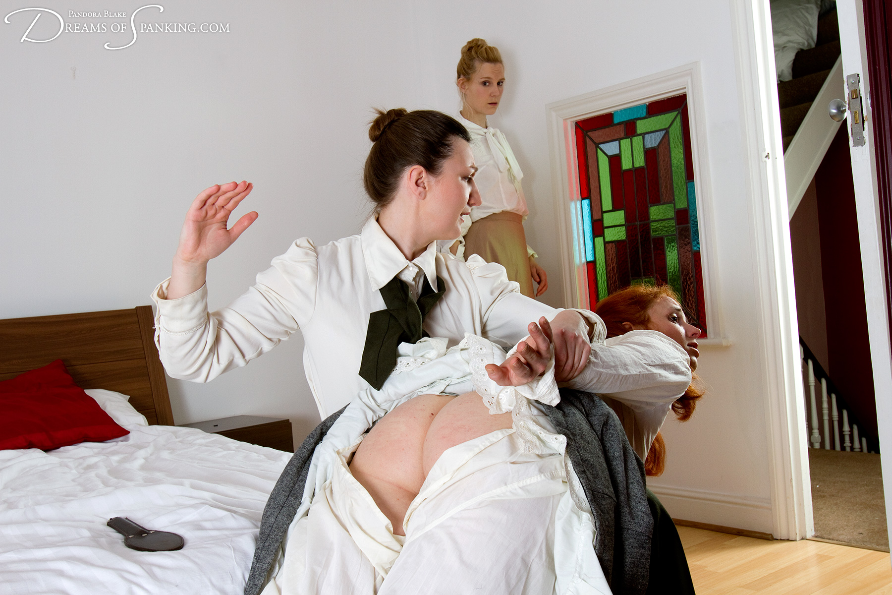 Caroline Grey is spanked and paddled over the knee by her strict Edwardian governess at Dreams of Spanking.