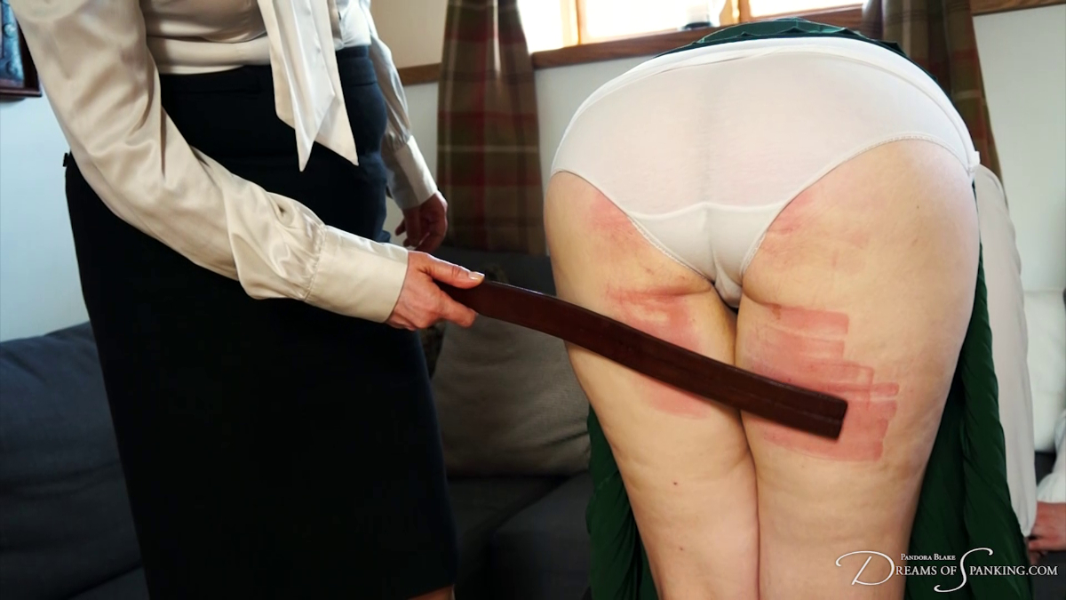 Pandora Blake gets the leather tawse on her thighs from Headmistress Clara Hewitt at Dreams of Spanking