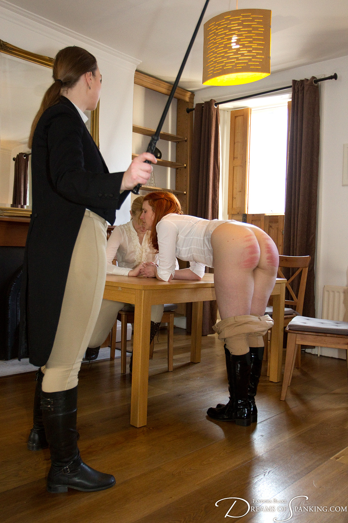 Caroline Grey whipped with a riding crop at Dreams of Spanking