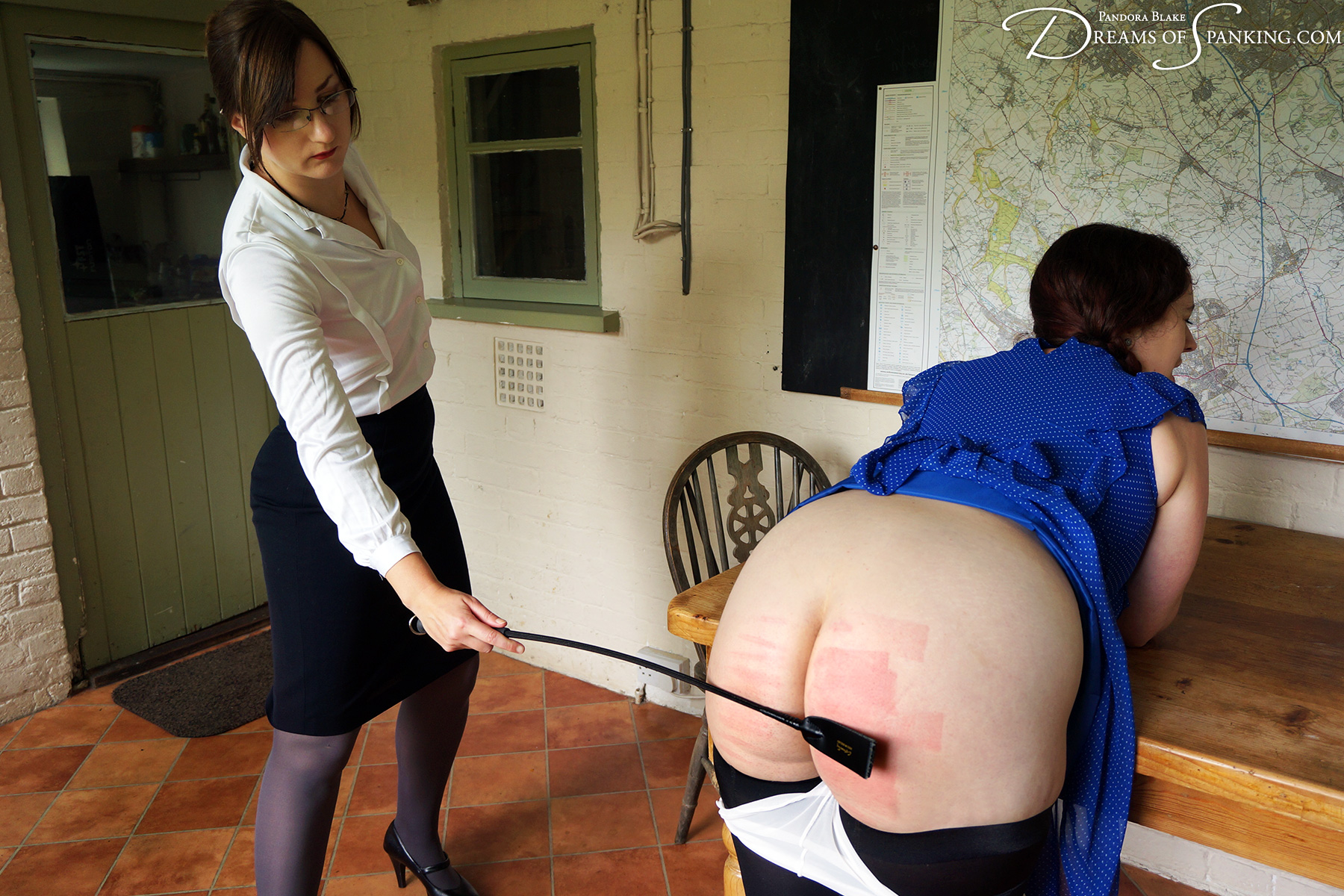 Nimue Allen bends over for a brisk riding crop whipping at Dreams of Spanking