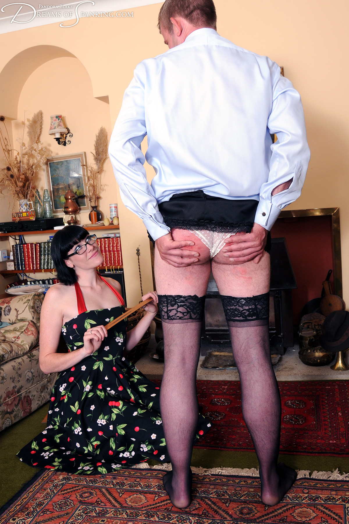 Cross-dressing, teasing and cane welts in flirty femdom spanking film The Loose Hem