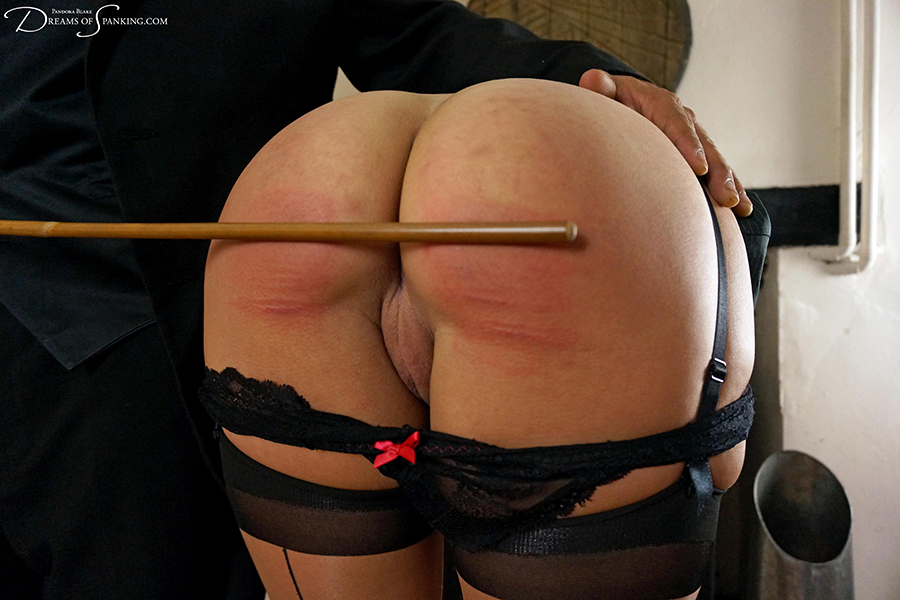 Submissive secretary Leia-Ann Woods bends over for a cold caning from her exacting boss at Dreams of Spanking