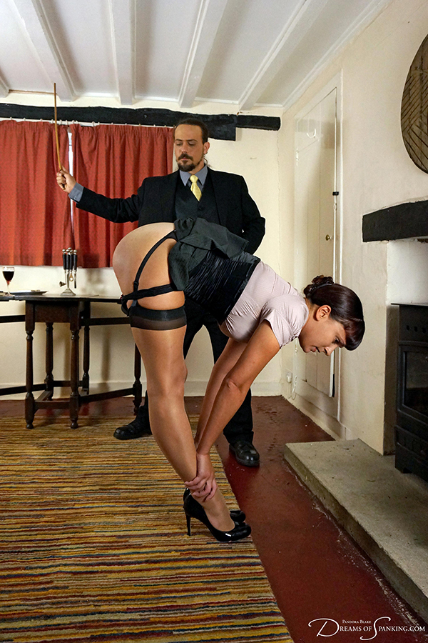Strict caning for submissive secretary Leia-Ann Woods at Dreams of Spanking