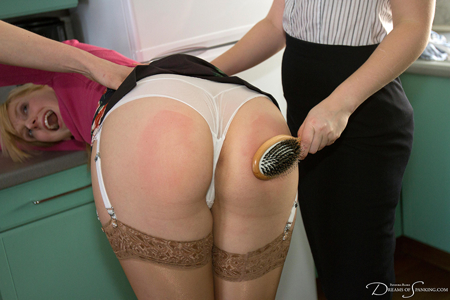 Lingerie spanking for Amelia Jane Rutherford with the wooden hairbrush