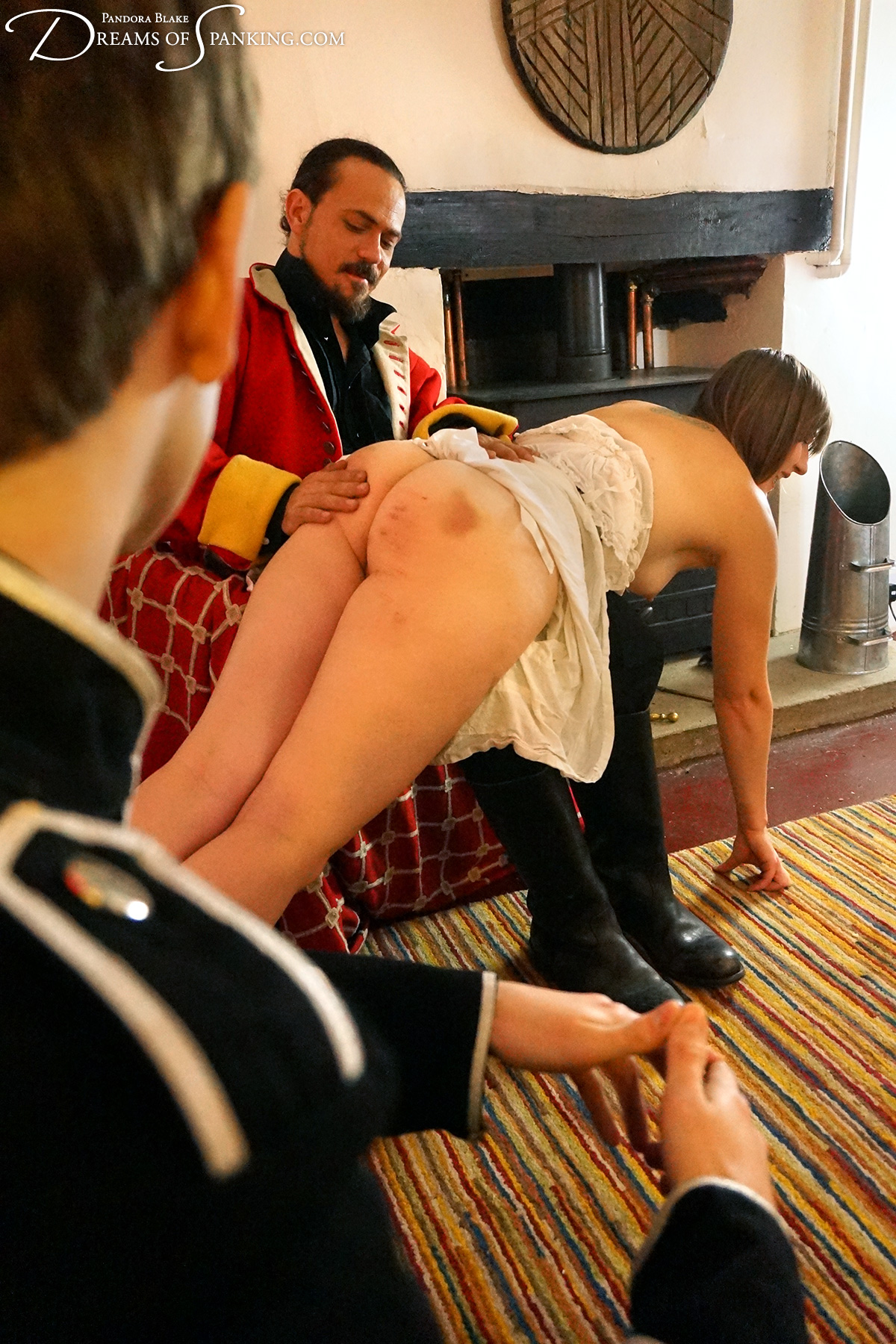The wench Pandora is punished and pleasured at the hands of the young officer and his superior