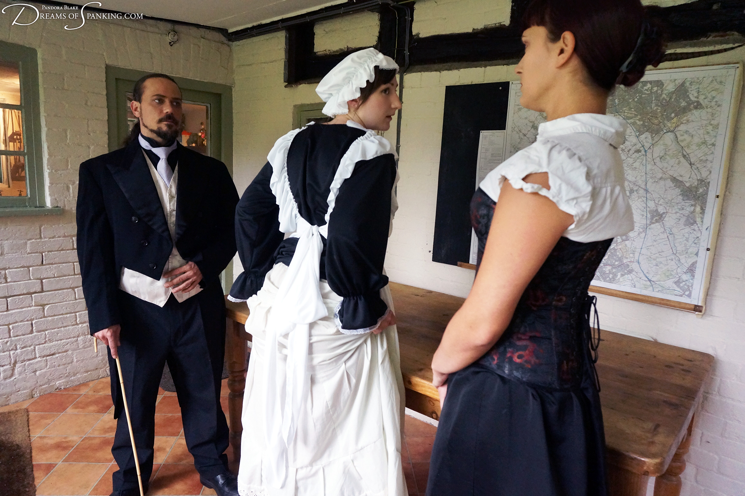 Hapless maidservant Pandora Blake bends over for a fifty stroke cold caning from Thomas Cameron and Leia Ann Woods