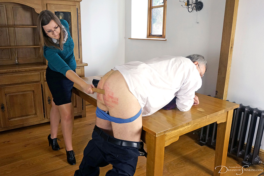 Headmaster Mike Pain bends over and offers his bottom to new teacher Pandora Blake at Dreams of Spanking