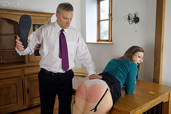New teacher Pandora Blake bends over the Headmaster's desk for the slipper at Dreams of Spanking