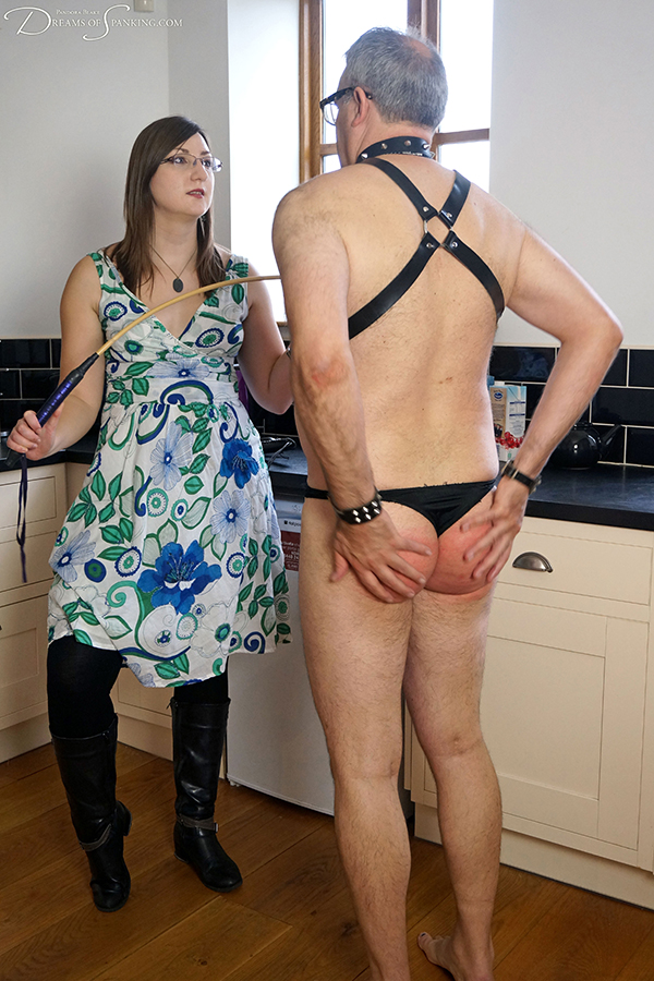 Fierce femdom Pandora Blake gives Mike Pain a hard strapping and severe caning at Dreams of Spanking