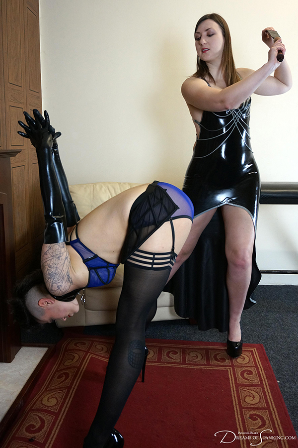 Ms Vixxxen assumes the position for the strap at Dreams of Spanking