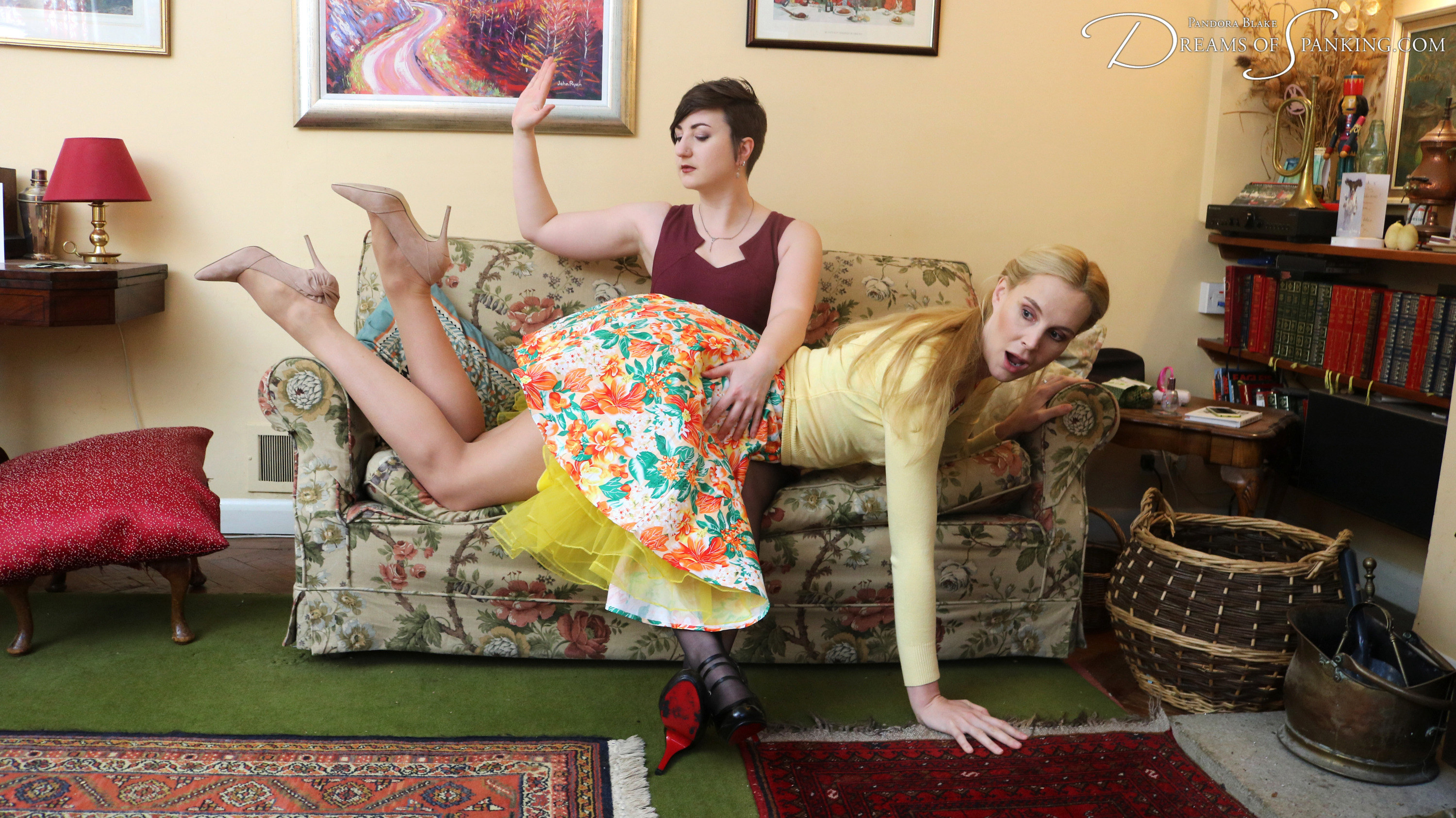 Amelia Jane Rutherford has a bright red spanked bottom at Dreams of Spanking