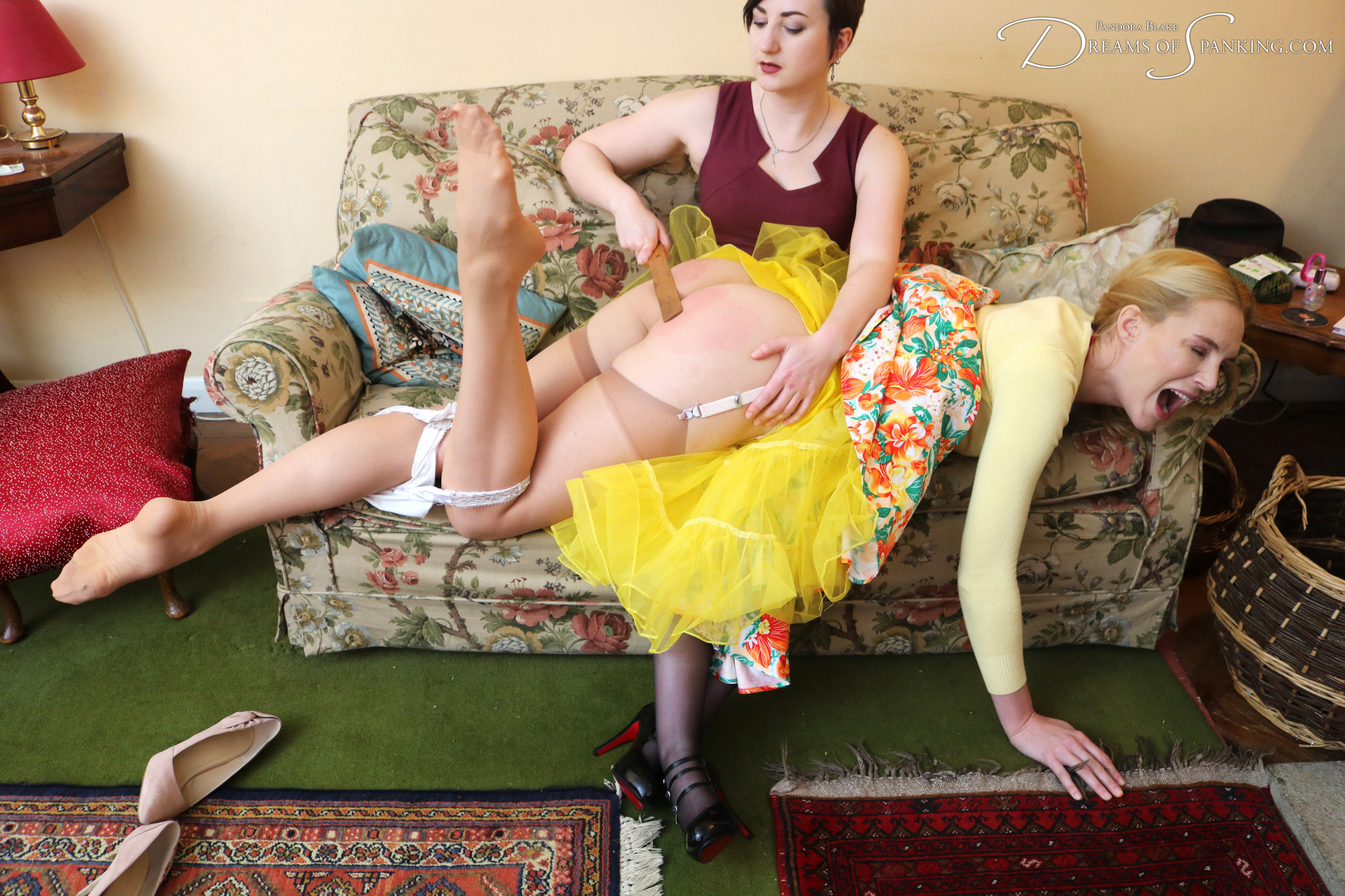 Amelia Jane Rutherford gets the wooden ruler on her bare bottom from Pandora Blake at Dreams of Spanking