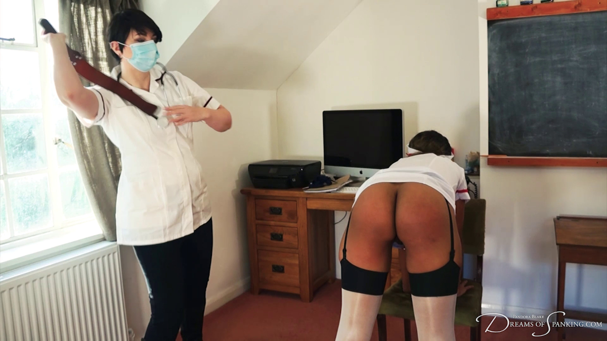Matron Blake uses the leather strap on nurse Lana Moon at Dreams of Spanking