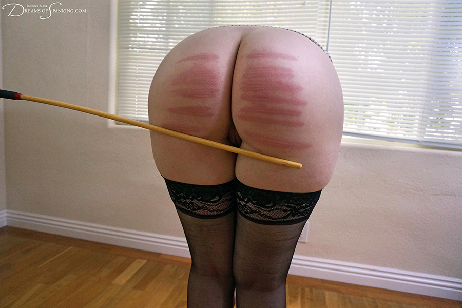 Pandora Blake touches her toes for an office caning