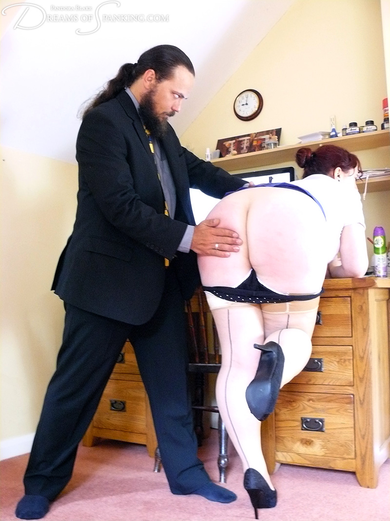 Nimue spanked and paddled in the office at Dreams of Spanking