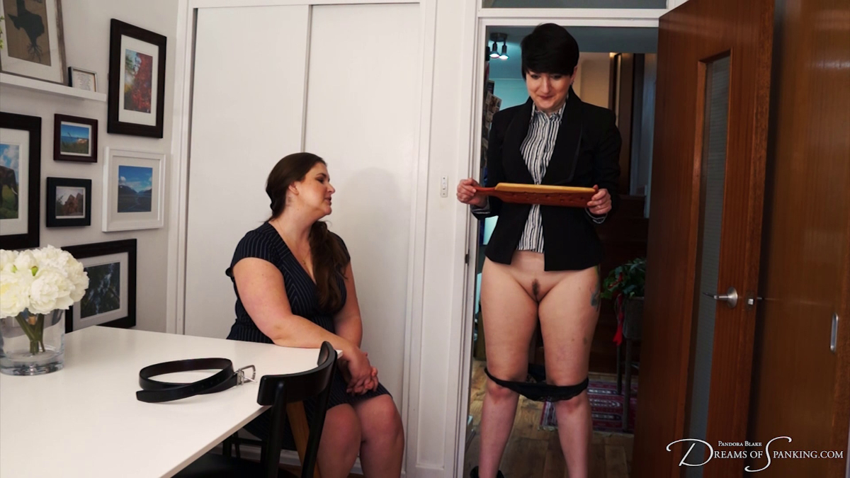 Pandora Blake has her knickers around her knees, embarrassed as Kelley May looks at her at Dreams of Spanking