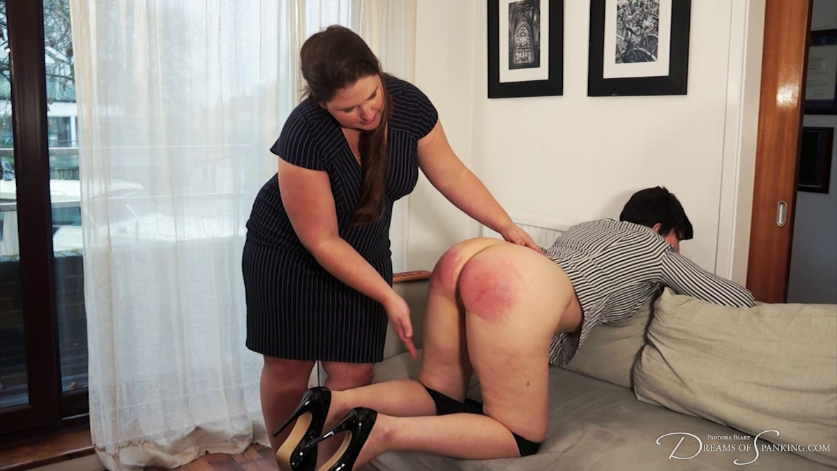 Kelley May spanks Pandora Blake's exposed pussy at Dreams of Spanking